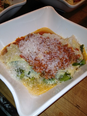 Broccoli stuffed Tortelloni in a sausage tomato ragu